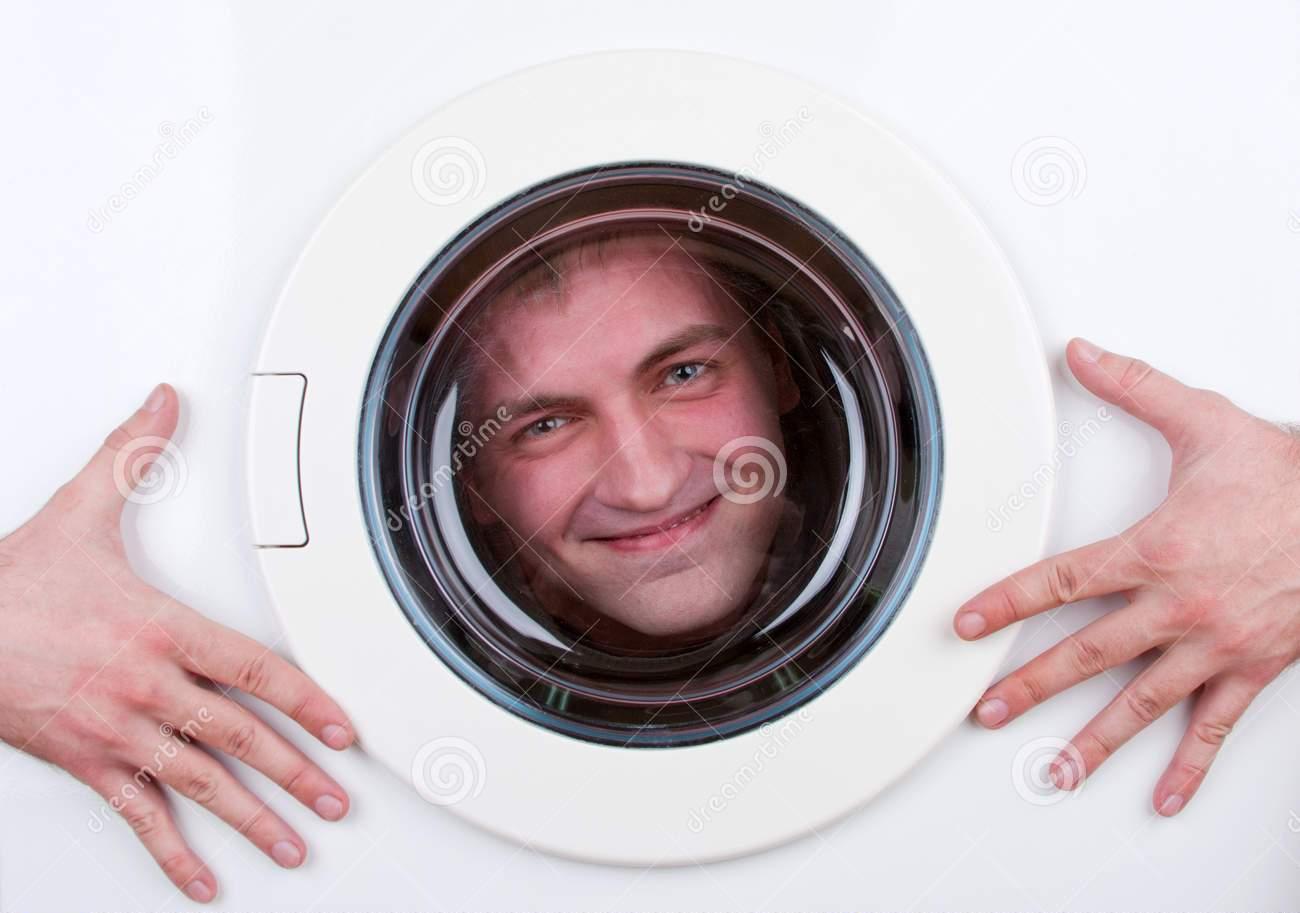 happy-man-inside-washing-machine-18223400